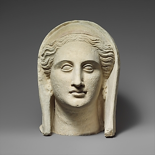 Limestone head of a veiled female votary