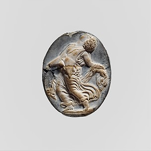 Cameo glass medallion of a maenad