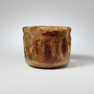Glass cup with indented sides