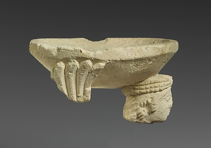 Limestone fragment of a sphinx supporting an incense burner