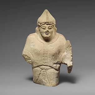 Limestone statuette of a warrior holding a shield