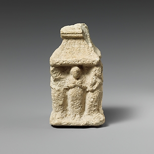 Limestone naiskos with female figures holding their breasts