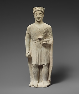 Limestone statuette of a beardless male votary holding a bird