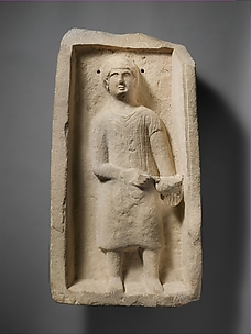 Limestone funerary stele of a boy