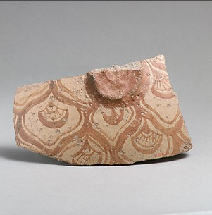 Terracotta vessel fragment with reticulated pattern enclosing conventional flowers