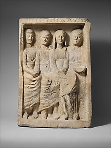 Limestone funerary monument with four figures