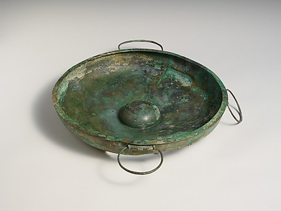 Two bronze swinging handles, perhaps from phialai (libation bowls)