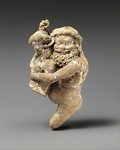 Terracotta statuette of a satyr and maenad