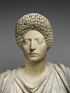 Marble statue of Tyche-Fortuna restored with the portrait head of a woman