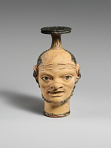 Terracotta vase with janiform heads