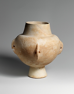 Marble vase with high foot and four lug handles