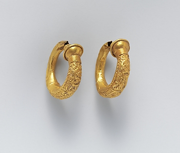 Gold trumpet-shaped earrings with relief decoration