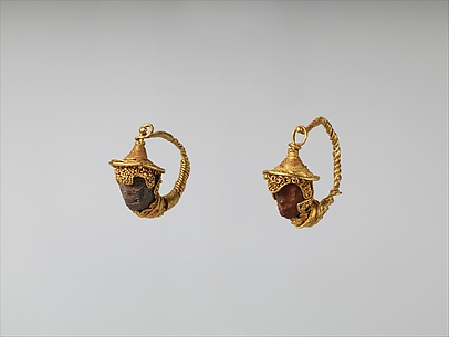 Gold and amber earrings with head of a black youth
