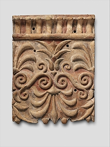 Terracotta architectural plaque with lotus and palmette designs