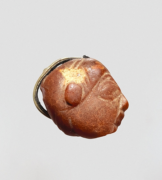 Pendant: winged female head