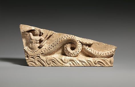 Limestone pediment fragment