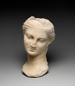 Marble head of a girl from a small statue