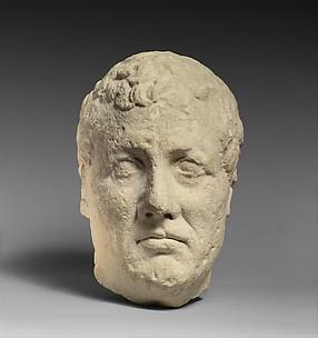 Limestone head of beardless male votary