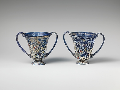 A pair of glass drinking cups