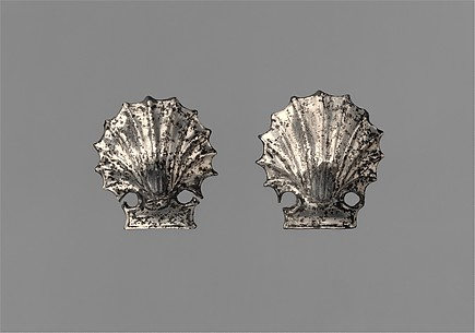 Pair of silver attachments in the form of seashells