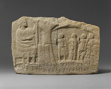 Limestone inscribed relief