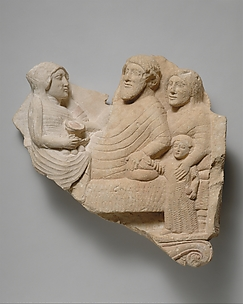 Fragment of a limestone grave relief with a banquet scene