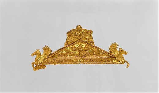 Gold pediment-shaped brooch
