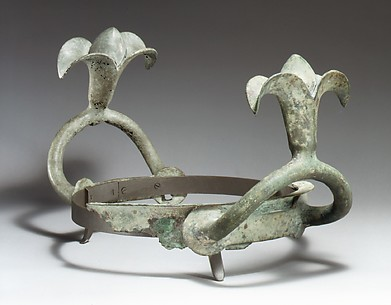 Bronze handles and part of the rim of a cauldron