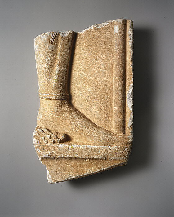 Fragmentary marble grave stele of a hoplite (foot soldier)