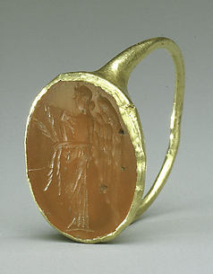 Gold ring with carnelian intaglio: winged Nemesis