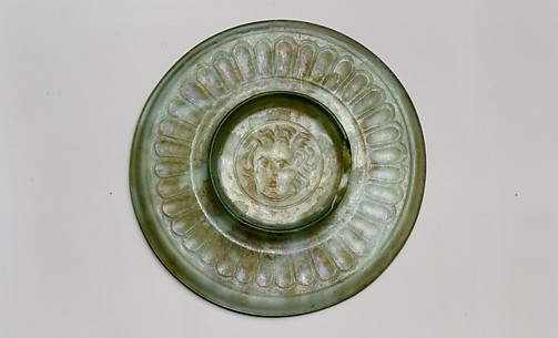 Small glass plate with head of Medusa