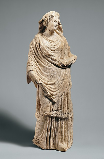 Terracotta statuette of a draped goddess