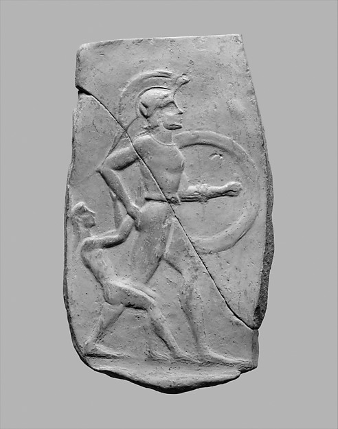Terracotta relief of a warrior dragging a captive