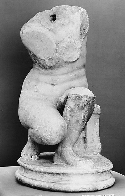 Marble statue of a crouching Aphrodite