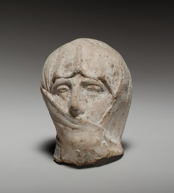 Terracotta head of a veiled woman