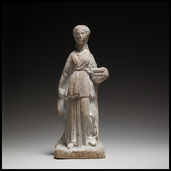 Terracotta figuring of a standing female votary holding a box