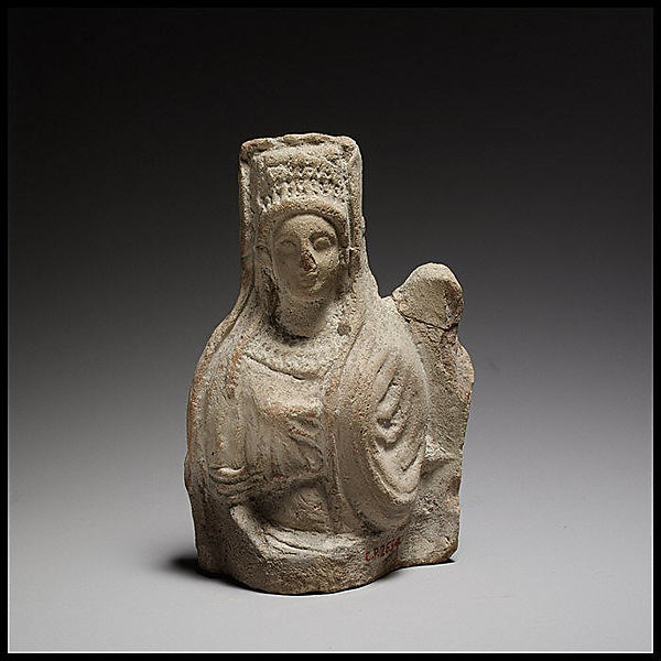 Terracotta statuette of a seated goddess