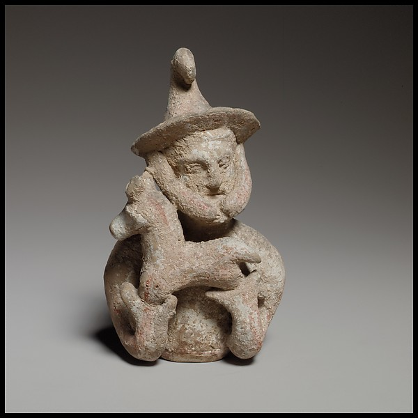 Terracotta statuette of a male votary offering a kid