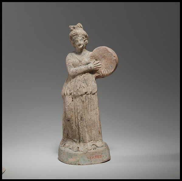 Terracotta statuette of woman playing a tympanon