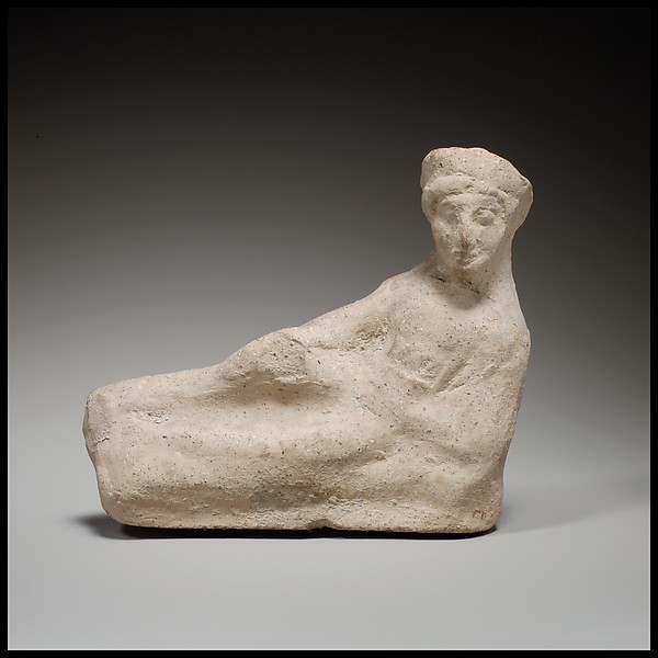 Terracotta statuette of a reclining youth