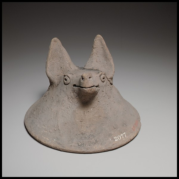 Terracotta mask in the shape of the head of a fox, dog, or bat