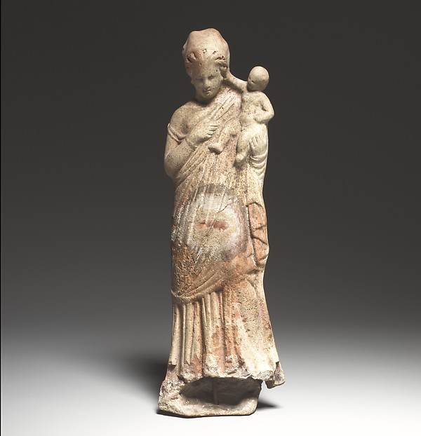 Terracotta statuette of a woman holding a baby