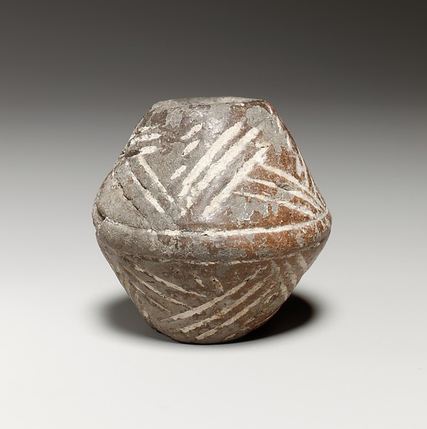 Terracotta biconical spindle-whorl with flat top