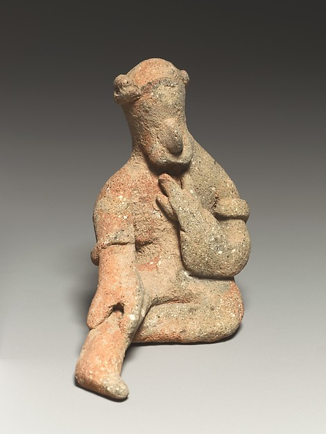 Seated male figurine