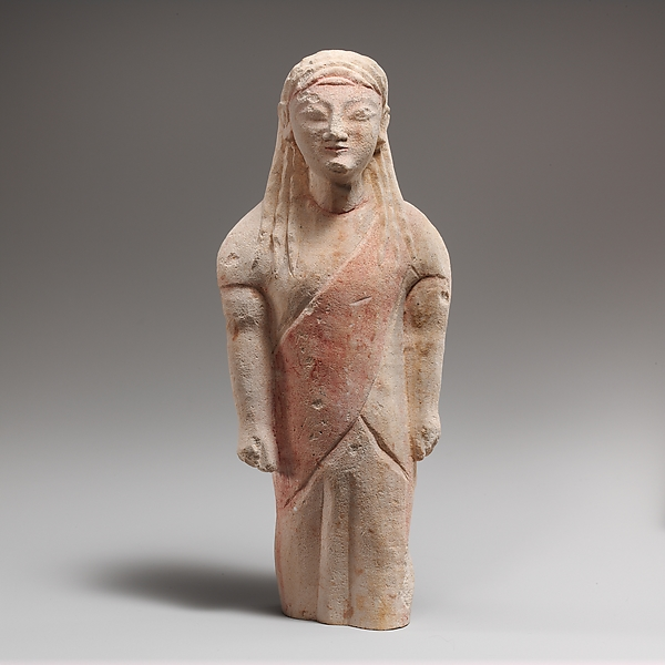 Limestone statuette of beardless male votary in Greek dress