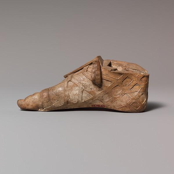 Ivory sandaled foot