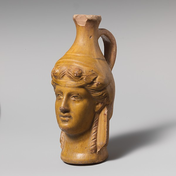 Terracotta jug in the form of Dionysos