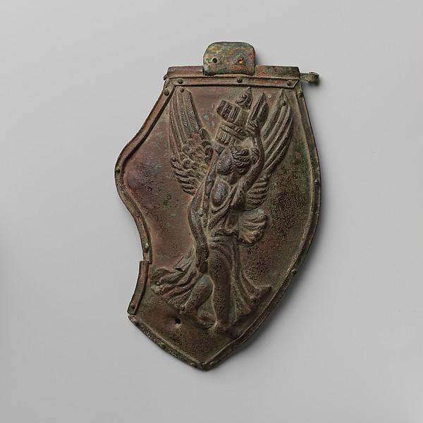 Bronze cheek piece of a helmet