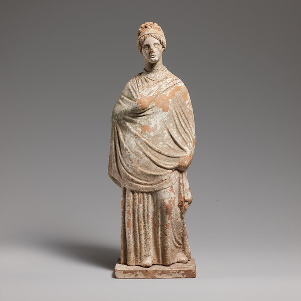 Terracotta statuette of a standing woman