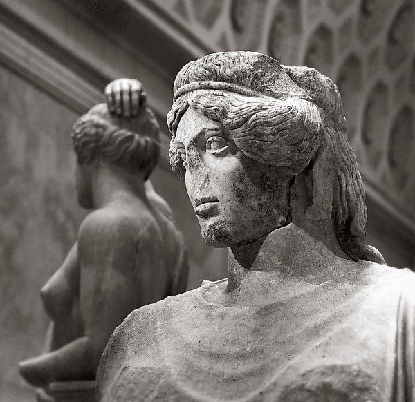 Upper part of a marble statue of a woman